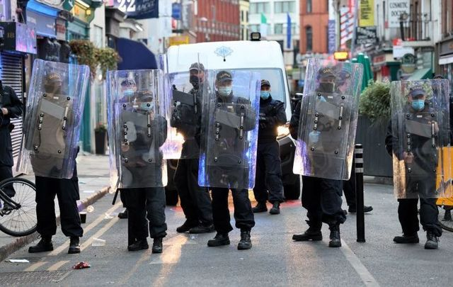 June 5, 2021: Members of the An Garda Siochana Public Order unit move on crowds of people in Dublin City Center on Saturday night in Dublin.