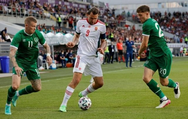June 8, 2021: Adam Szalai of Hungary is challenged by James McClean and Dara O\'Shea of Republic of Ireland during the international friendly match between Hungary and Republic of Ireland at Szusza Ferenc Stadion on in Budapest, Hungary.