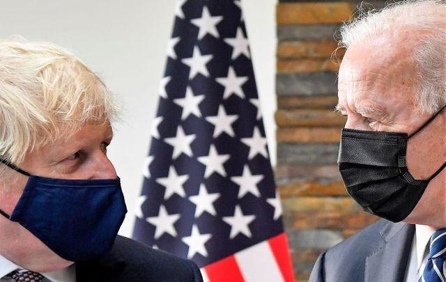 June 10, 2021: UK Prime Minister Boris Johnson speaks with U.S. President Joe Biden at Carbis Bay Hotel near St Ives, England.