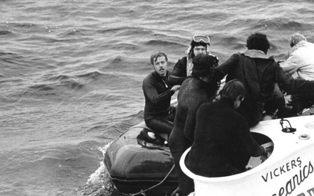 Divers rescue Pisces III pilots Roger Champan and Roger Mallinson after a grueling three-day multinational effort.