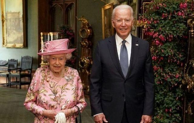 June 13, 2021: Queen Elizabeth II with US President Joe Biden in the Grand Corridor during their visit to Windsor Castle in Windsor, England.