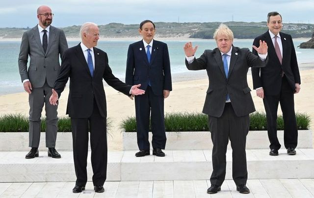 June 11, 2021:  (L-R) President of the European Council Charles Michel, US President Joe Biden, Japanese Prime Minister Yoshihide Suga, British Prime Minister Boris Johnson, and Italian Prime Minister Mario Draghi pose at the G7 Summit in Carbis Bay, Cornwall.