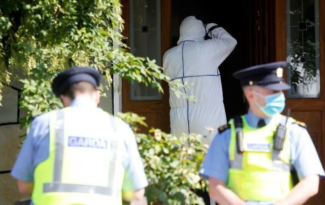 June 21, 2021: Garda wearing face masks as Technical Bureau (Forensic Teams) arrive outside a house in Carriglea View, a housing estate in Firhouse in Dublin where a man was fatally stabbed on June 20.