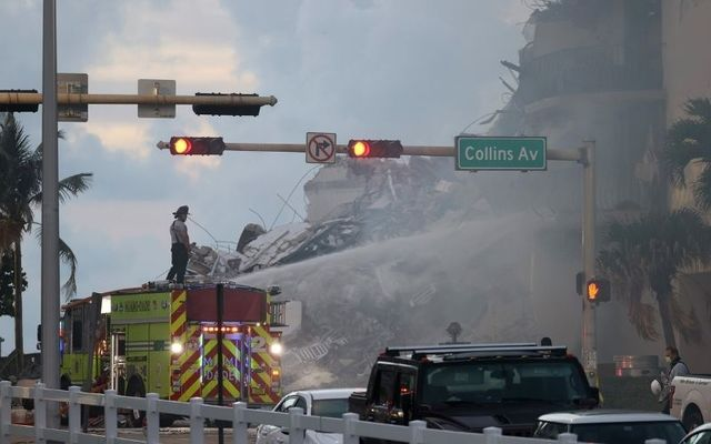 Search and rescue teams respond to the collapse of a 12-story tower in Surfside, Florida.\n