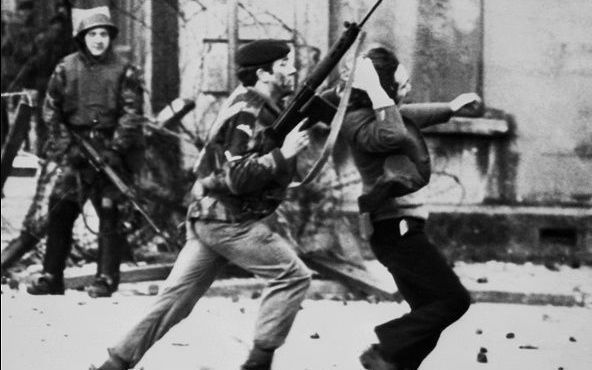 A British soldier shoves a civilian during Bloody Sunday in Derry.