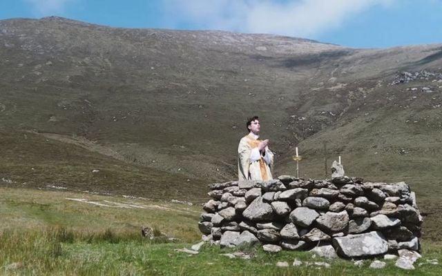 A priest celebrates mass at a Mass Rock
