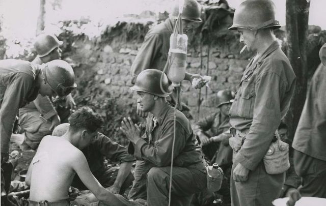 US soldiers receiving medical care during the Korean War.