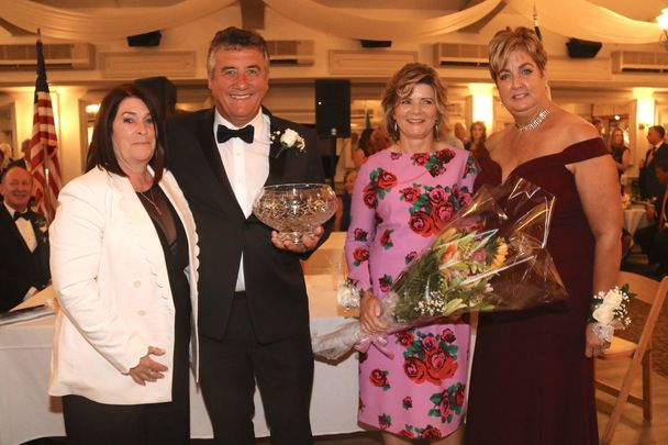 New York GAA Chairperson Joan Henchy (far left) and treasurer Clare McCartney (far right) with two of the honorees at this year's dinner dance, Seamus and Caitriona Clarke.
