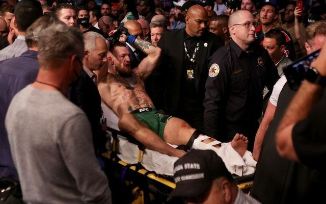 Conor McGregor departs Las Vegas\'s T-Mobile Arena on a stretcher following his defeat to Dustin Porier.
