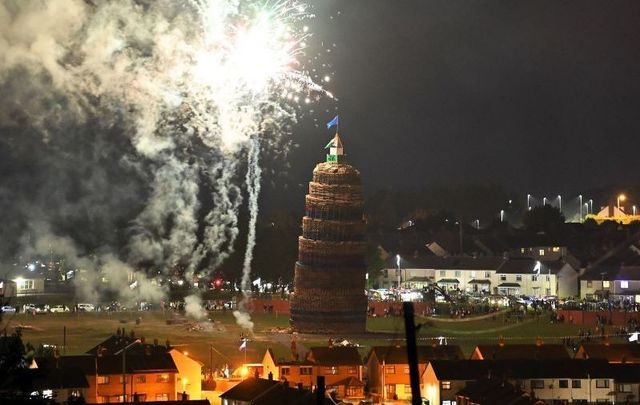 July 12, 2021: The 11th night bonfire which marks the beginning of the annual protestant 12th of July celebrations is lit in the Craigyhill housing estate in Larne, Northern Ireland.