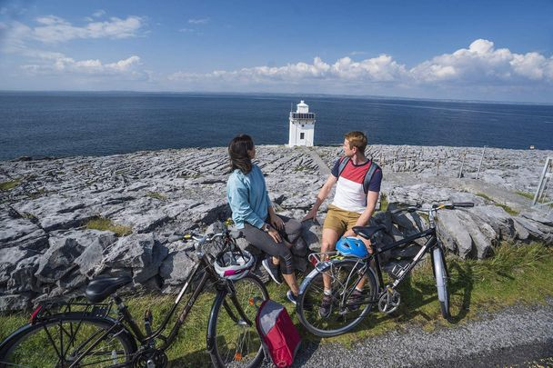 Black Head Lighthouse, The Burren, County Clare: Take a 70-kilometer bike ride around the karst landscape in the southwest of Ireland.