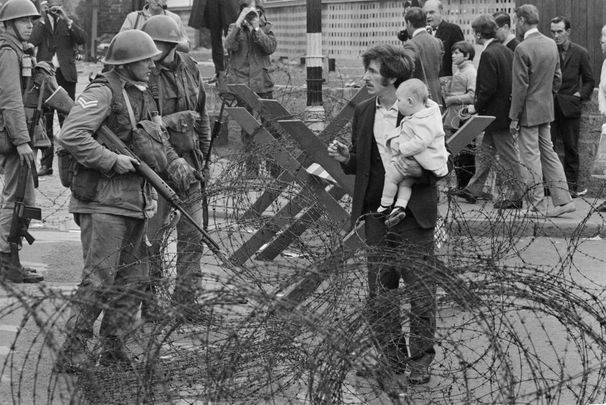 Soldiers and civilians in Northern Ireland during The Troubles, 16th August 1969.