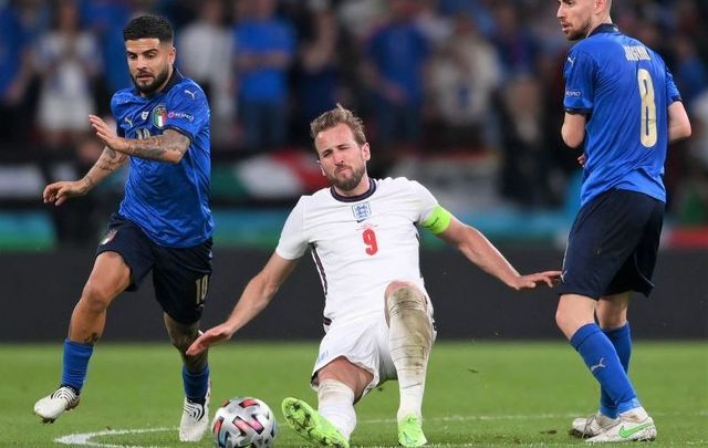 July 11, 2021: Harry Kane of England is challenged by Lorenzo Insigne and Jorginho of Italy during the UEFA Euro 2020 Championship Final between Italy and England at Wembley Stadium in London, England.