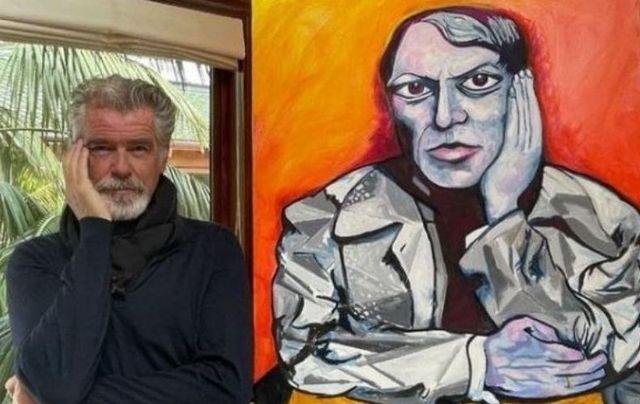 Pierce Brosnan alongside one of his paintings.