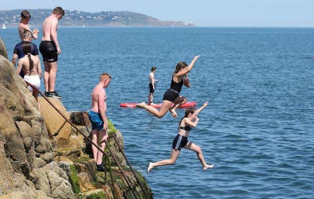 July 21, 2021: People flock to Sandycove Beach in Dublin amid Ireland\'s heatwave.