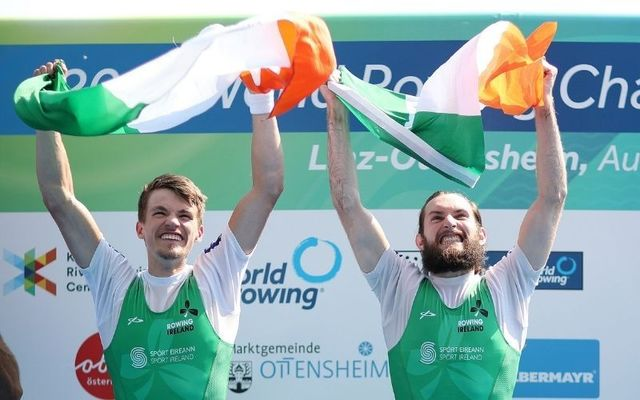 Fintan McCarthy (left) and Paul O\'Donovan (right) celebrate winning the men\'s lightweight double sculls event at the 2019 World Rowing Championships in Austria.