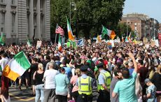 """Anti-vaccine passport protesters shout """"freedom"""" in Dublin and Belfast"""