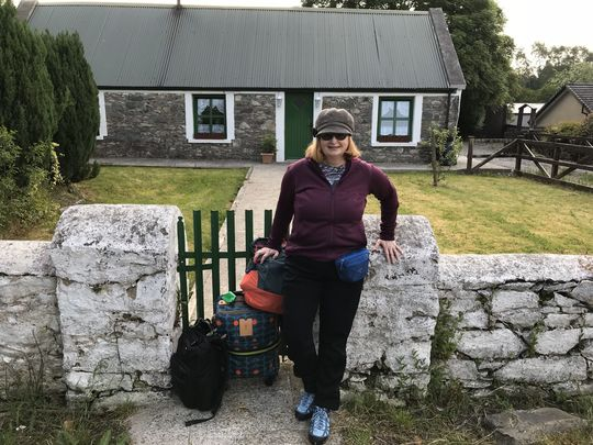Jannet L. Walsh, of Murdock, Minnesota, poses in front of Crosstown Cottage, near Killarney, County Kerry, Ireland, June 1, 2018, before heading to the railway station in Killarney.  Walsh spent most of May living in the historic cottage researching and writing about her family's Irish roots, and connecting with local Irish culture and people.