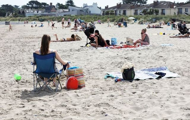 July 22, 2021: Burrow Beach in Sutton, Dublin, where members of the public gathered to enjoy the sun and go swimming amidst a heatwave.