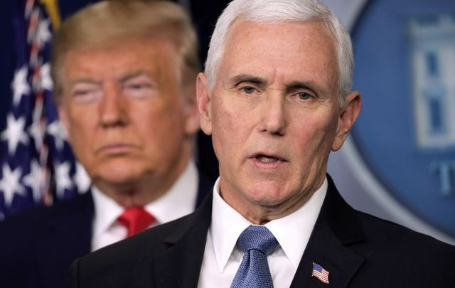 February 29, 2020: U.S. President Donald Trump listens as Vice President Mike Pence speaks during a news conference at the James Brady Press Briefing Room at the White House.