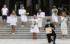 Irish brides stage protest in Dublin over number of guests permitted at weddings