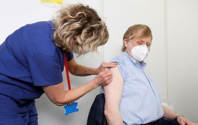 April 4, 2021: Jerry Leahy is given their first dose of the Covid-19 vaccine by nurse Margaret Dobbin at the HSE Vaccination Centre in the Aviva Stadium.