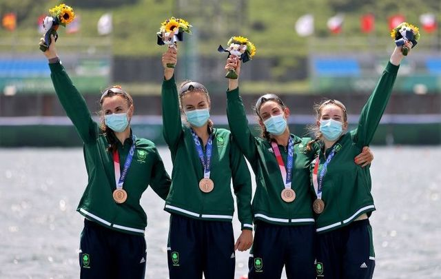 July 28, 2021: Bronze medalists Aifric Keogh, Eimear Lambe, Fiona Murtagh and Emily Hegarty of Team Ireland during the medal ceremony for the Women\'s Four Final A on day five of the Tokyo 2020 Olympic Games at Sea Forest Waterway in Tokyo, Japan.