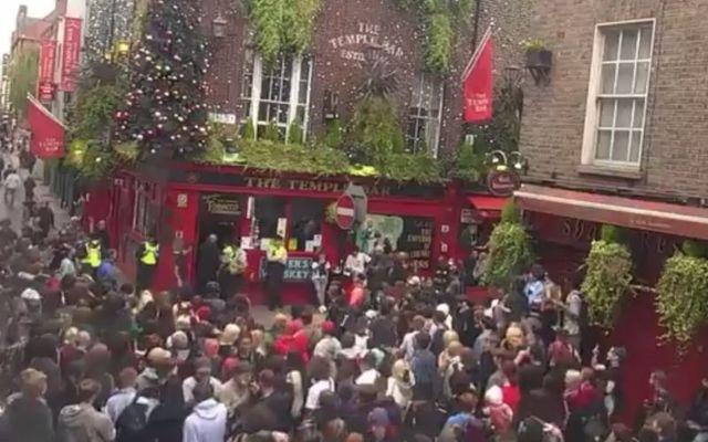 Protestors gather outside the Temple Bar pub in Dublin on Thursday.