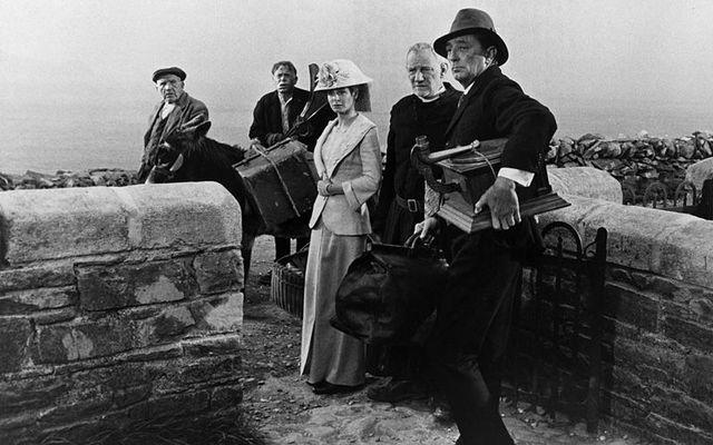 "Robert Mitchum along with actors John Mills, Sarah Miles, and Trevor Howard on set of \""Ryan\'s Daughter\"" in 1970."