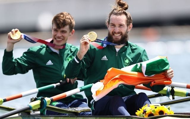 July 29, 2021: Gold medalists Fintan Mccarthy and Paul O\'Donovan of Team Ireland pose with their medals in their boat after the Lightweight Men\'s Double Sculls Final A on day six of the Tokyo 2020 Olympic Games at Sea Forest Waterway in Tokyo, Japan.