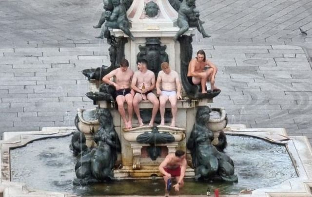 The Irish tourists were quickly apprehended and fined for scaling the Neptune Fountain in Bologna, Italy.