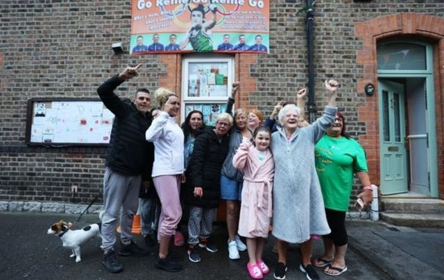 August 5, 2021: Lilly May (8), Lilly Fagan (known as the Grandmother of Portland Row), join neighbors outside the Portland Row home of Irish Olympic boxer Kellie Harrington to celebrate her win after watching Kellie win her fight getting her through to Sunday's Olympic boxing final in the lightweight division after today's semi-final win.