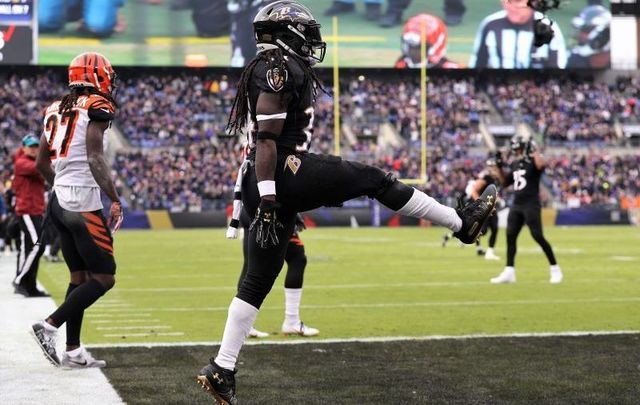 November 18, 2018: Alex Collins, then playing for the Baltimore Ravens, celebrates with some Irish dancing after scoring a touchdown against the Cincinnati Bengals at M&T Bank Stadium in Baltimore, Maryland.