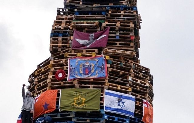 Nationalists erect a bonfire in Derry.