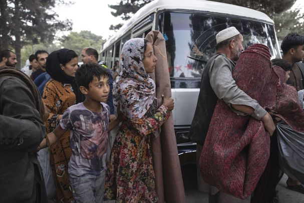 People displaced by the Taliban advancing are flooding into the Kabul capital to escape the Taliban takeover of their provinces. (Photo by Paula Bronstein/Getty Images)