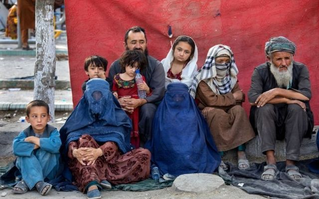 August 12, 2021: Charyar,70, from the Balkh province, sits alongside his family at a makeshift IDP camp in Share-e-Naw park to various mosques and schools in Kabul, Afghanistan. People displaced by the Taliban advancing are flooding into the Kabul capital to escape the Taliban takeover of their provinces.