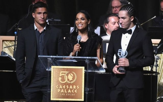 Nico Ali-Walsh (left) with his mother Rasheda and brother Biaggio at a 50th anniversary gala at Caesar\'s Palace in 2016.