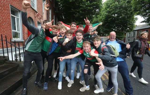 August 14, 2021: A group of Mayo fans gets photobombed by a Dublin supporter at Croke Park in Dublin ahead of the men\'s and women's GAA football semi-finals.