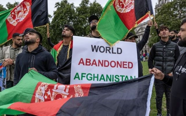 Afghan protestors gather in London after the Taliban stormed Kabul on Sunday.