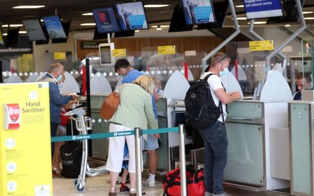 Travelers check in for flights at Dublin Airport.
