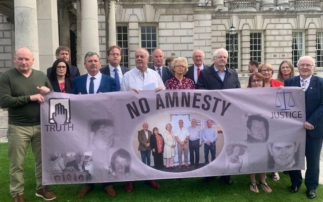 Victims of The Troubles with political parties outside Belfast City Hall \n