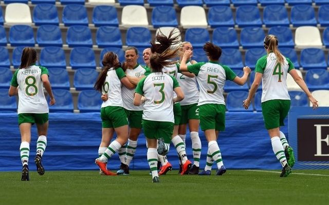 The Irish senior women\'s team celebrate with captain Katie McCabe after she scores against Italy in an international friendly in 2019.