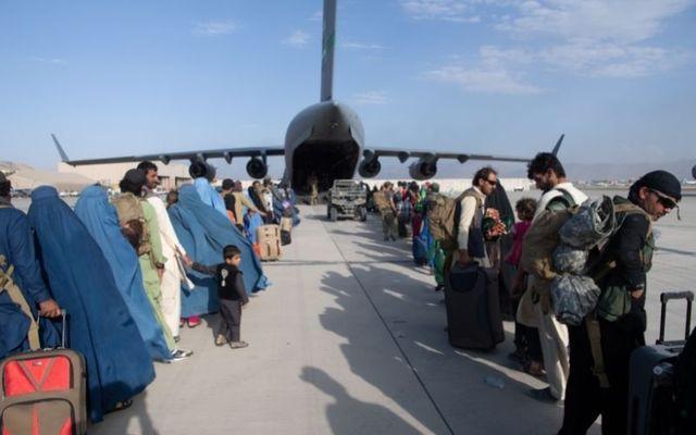 Afghan residents evacuate Afghanistan at Kabul International Airport on August 24.