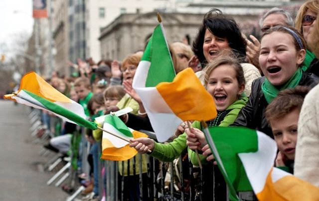 March 17, 2012: Revelers cheer on the marchers during the 251st annual St. Patrick\'s Day Parade in New York City.