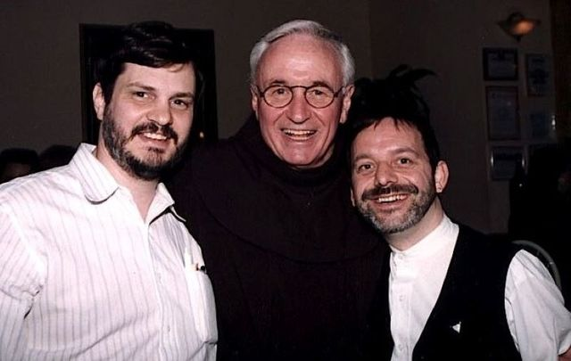 Dr. Tom Moulton and his spouse Brendan Fay flank Father Mychal Judge in a favorite photo.