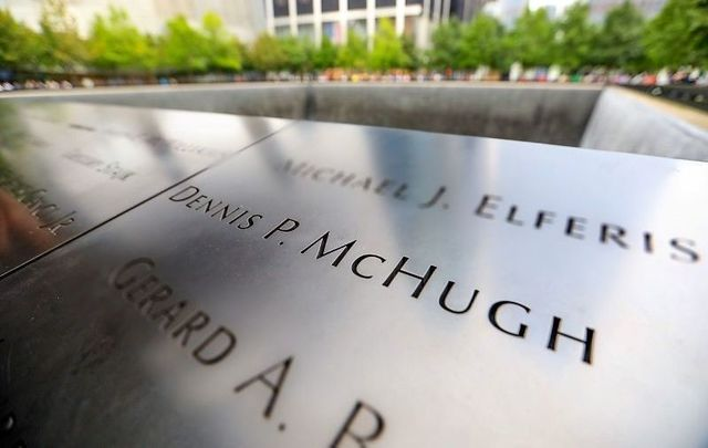 Dennis P. McHugh\'s name on Panel 5-18 at the South Memorial Pool at the 9/11 Memorial in New York City.