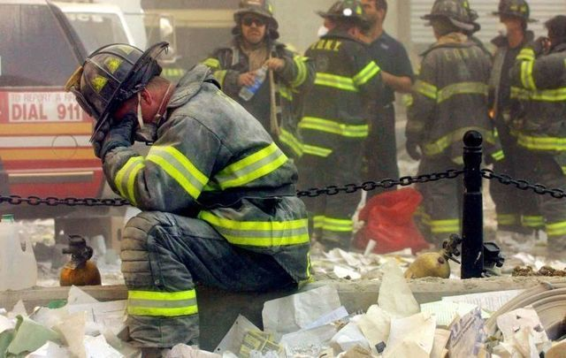 A firefighter pauses during search and rescue efforts on 9/11.