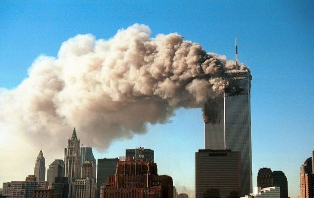 The Twin Towers burn moments before collapsing on 9/11.