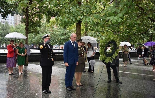 Simon Coveney (center) lays a wreath at the 9/11 Memorial.