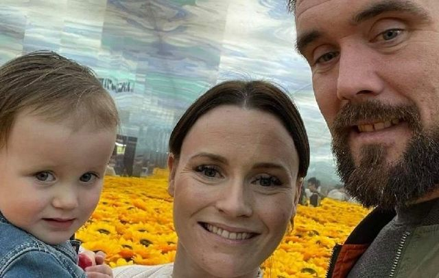 Shane McGeough, his partner Michelle, and their daughter.